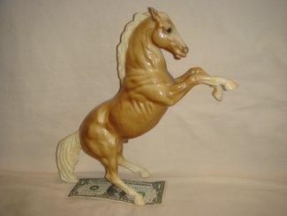 Glossy palomino Fighting Stallion King